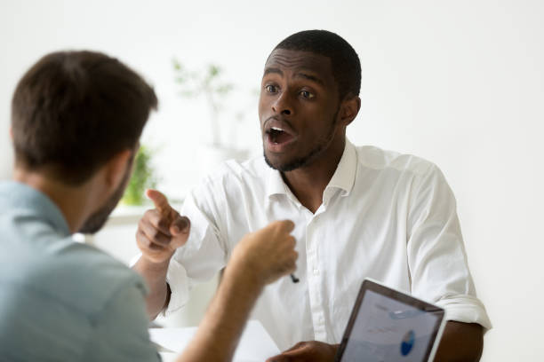 African-american businessman disagreeing debating during negotiations disputing with caucasian colleague African american businessman disagreeing arguing debating during office negotiations, black negotiator disputing with caucasian partner, insisting on point of view in discussion, explaining opinion shock tactics stock pictures, royalty-free photos & images