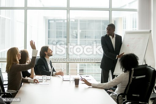 istock African-american businessman giving presentation answering questions of multi-ethnic business group 923039538