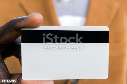 844190384 istock photo African-American businessman holding a blank credit card 864630060