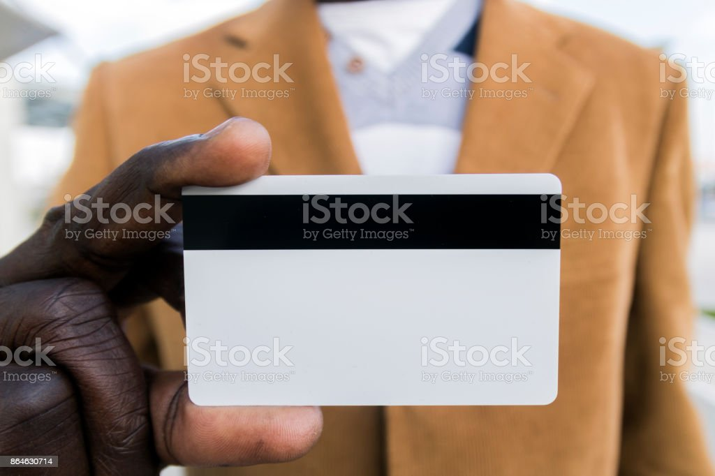 African-American businessman holding a blank credit card stock photo