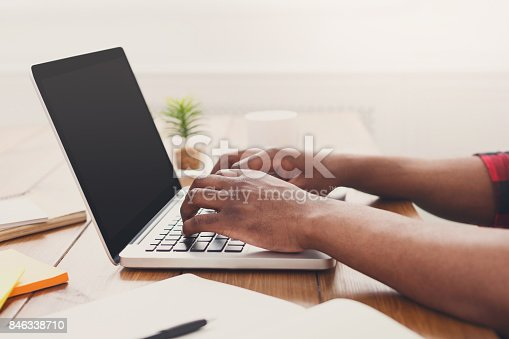 istock African-american businessman in office, closeup 846338710