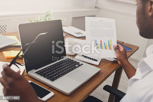 istock African-american businessman in office, closeup 849211692