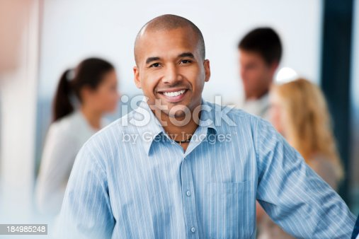 istock African-American businessman looking at camera. 184985248