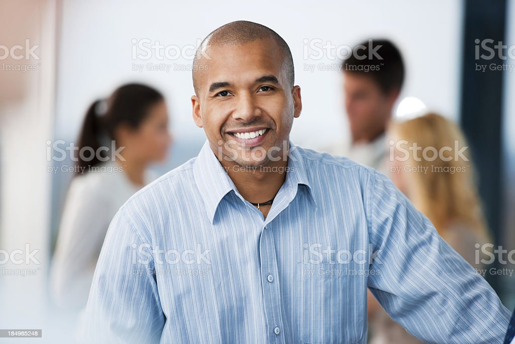African-American businessman looking at camera. stock photo