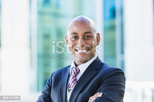 istock African-American businessman outside office building 926737582