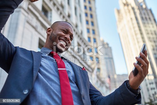 istock African-american businessman receiving great news on mobile phone 923305060
