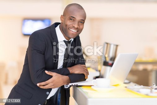 istock African-American businessman smiling 461212333