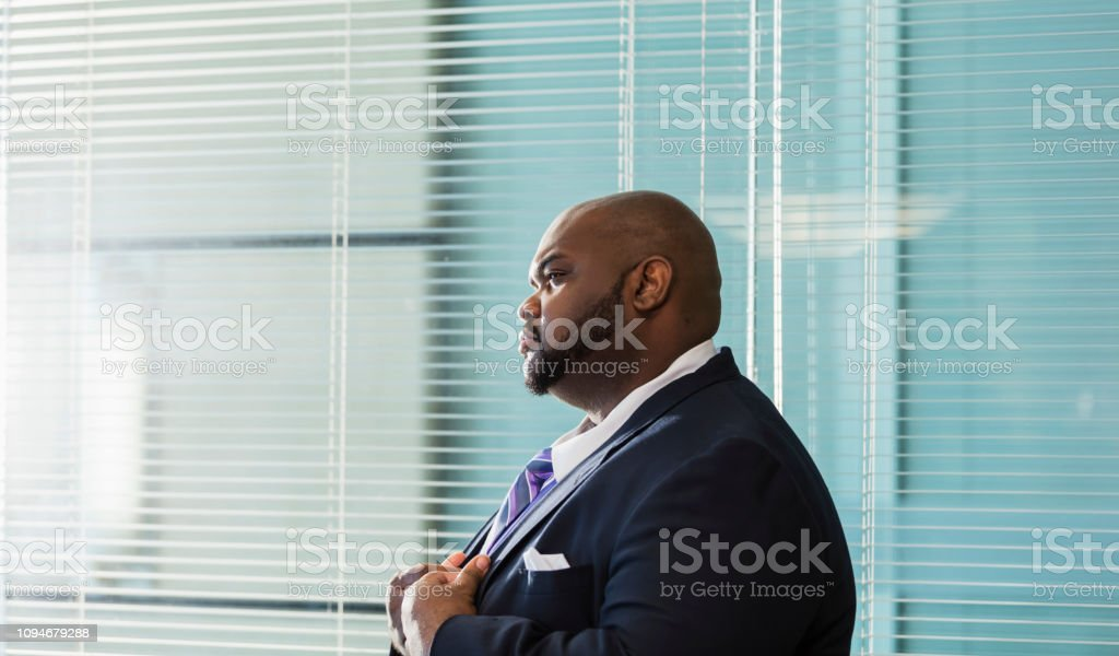 Profile view of a mature African-American businessman in his 40s...