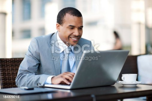 1053499704 istock photo African-American businessman working on his laptop. 184329215