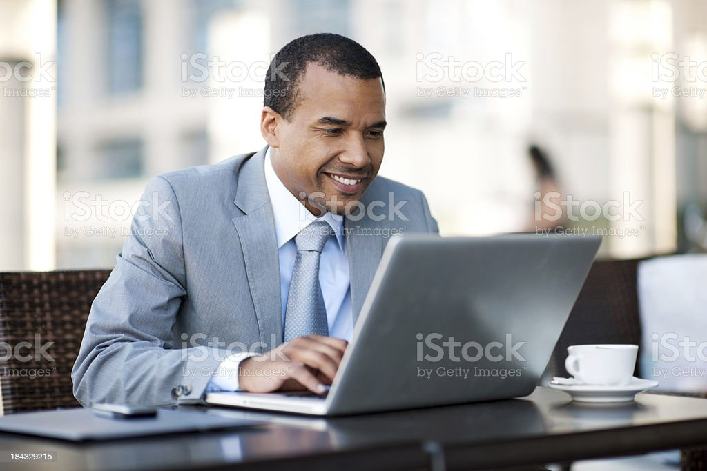 African-American businessman working on his laptop. stock photo