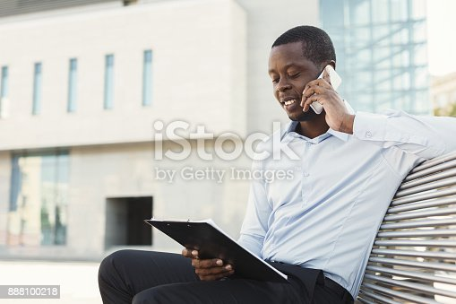 istock African-american businessman working with papers outdoors 888100218
