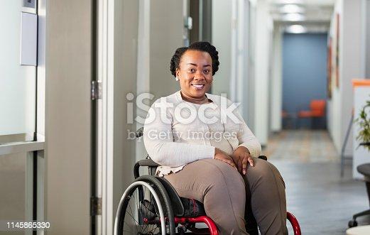 istock African-American businesswoman in wheelchair 1145865330