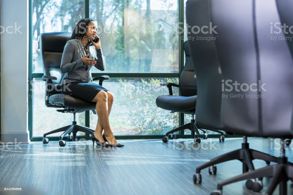 African-American businesswoman talking on phone stock photo