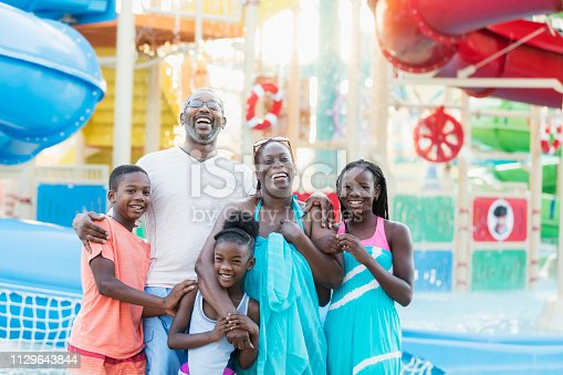 istock African-American children and grandparents at water park 1129643844