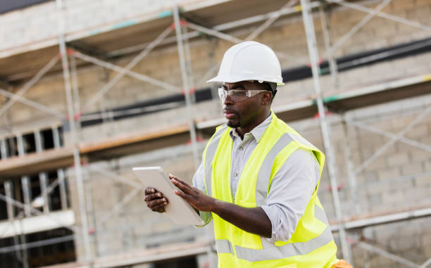 African-American construction worker with digital tablet stock photo