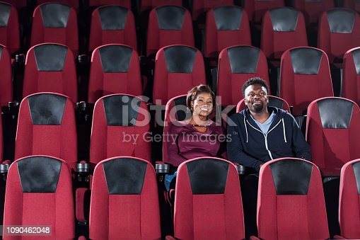 istock African-American couple alone in movie theater 1090462048