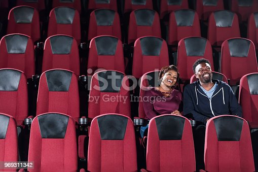 istock African-American couple alone in movie theater 969311342