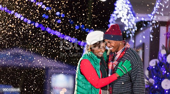 istock African-American couple enjoying winter festival 990458846