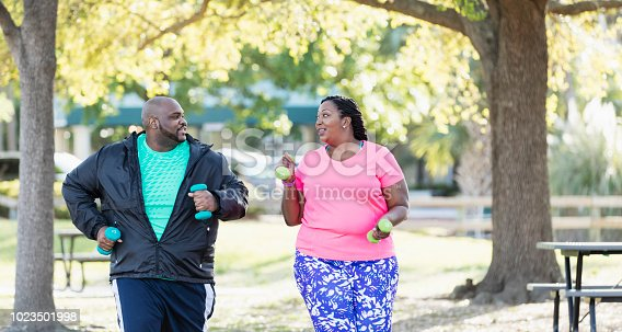 istock African-American couple exercising together 1023501998