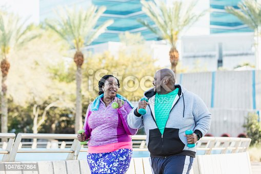 istock African-American couple exercising together 1047627864