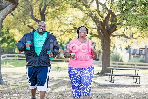istock African-American couple exercising together 990466580