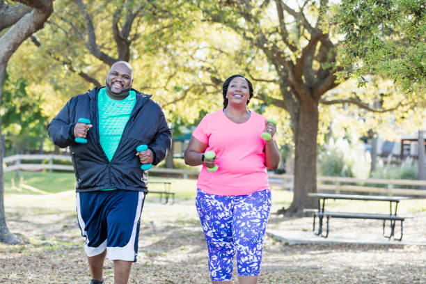 african-american couple exercising together - obesity foto e immagini stock