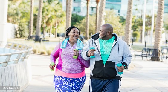 istock African-American couple exercising together 990466826