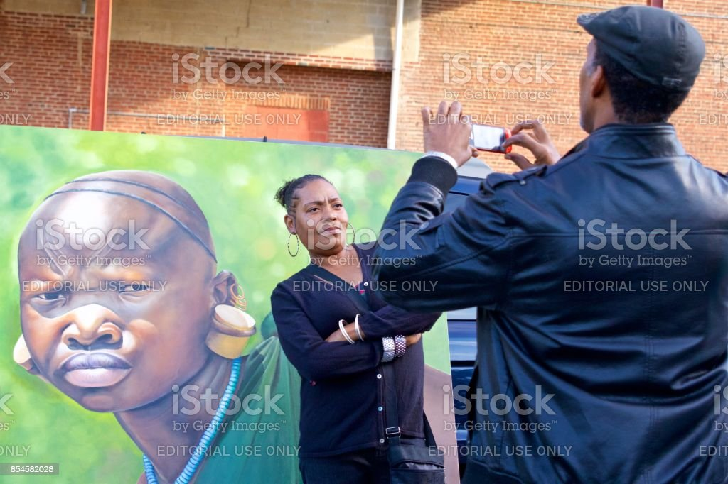 African-American couple posing for selfies stock photo