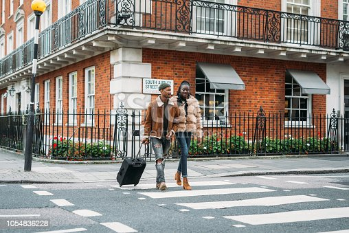istock African-American couple traveling to London for the honeymoon 1054836228