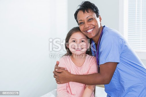 istock African-American doctor or nurse with young patient 683330278