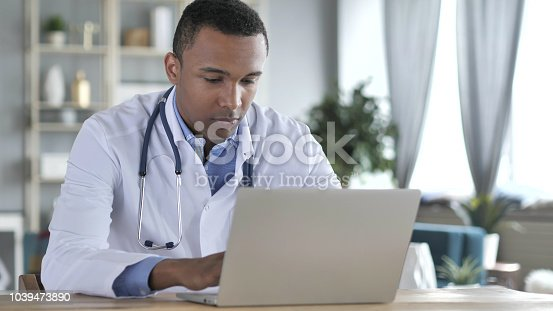 African-American Doctor Working On Laptop