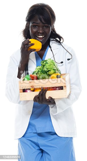 istock African-american ethnicity female doctor standing in front of white background wearing lab coat and holding crate 1246335520