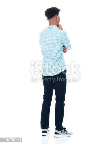 istock African-american ethnicity teenage boys standing in front of white background wearing pants 1212797448