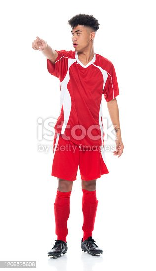 istock African-american ethnicity young male athlete standing wearing soccer uniform and holding soccer ball and playing soccer - sport and using sports ball 1206525606