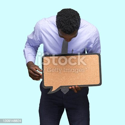 Waist up of african-american ethnicity young male business person standing in front of colored background who is contemplating who is showing with hand and holding questionnaire with copy space