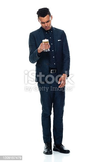 istock African-american ethnicity young male businessman relaxing in front of white background wearing business casual and holding beer - alcohol 1209157479