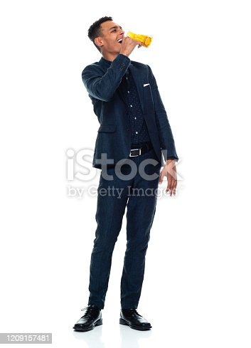 istock African-american ethnicity young male businessman relaxing in front of white background wearing businesswear and holding ale 1209157481