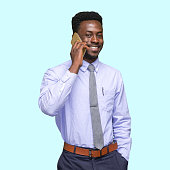 istock African-american ethnicity young male businessman standing in front of colored background wearing necktie and using mobile phone 1209148879