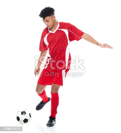 istock African-american ethnicity young male soccer player jogging and holding soccer ball and playing soccer - sport and using sports ball 1206525701