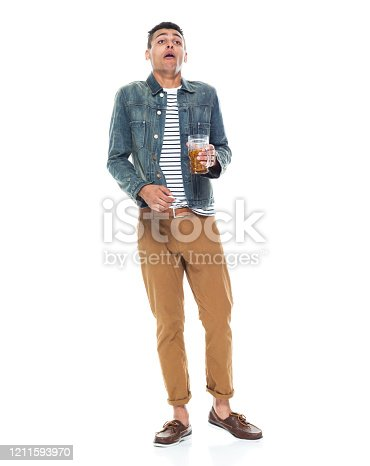 istock African-american ethnicity young male standing in front of white background wearing denim jacket and holding ale 1211593970
