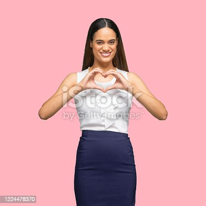 istock African-american ethnicity young women business person standing in front of colored background wearing smart casual 1224478370