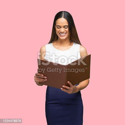istock African-american ethnicity young women business person standing in front of colored background wearing smart casual and holding paperwork 1224478375