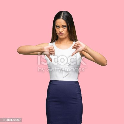 istock African-american ethnicity young women business person standing in front of colored background wearing smart casual 1246907997