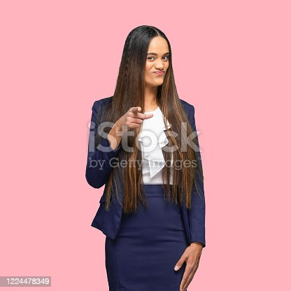 istock African-american ethnicity young women businesswoman standing in front of colored background wearing skirt 1224478349