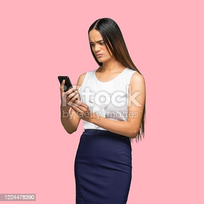 istock African-american ethnicity young women businesswoman standing in front of colored background wearing smart casual and using smart phone 1224478390