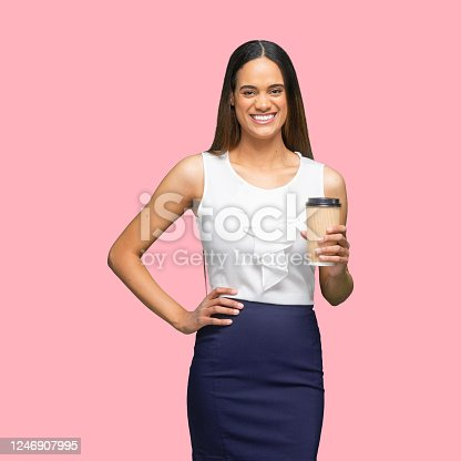 One person of aged 30-39 years old who is beautiful with long hair african-american ethnicity young women businesswoman standing in front of colored background wearing smart casual who is laughing and holding coffee cup