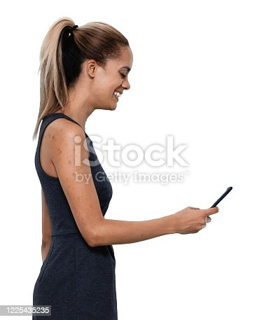 istock African-american ethnicity young women manager standing in front of white background in the office wearing businesswear and using smart phone 1225435235