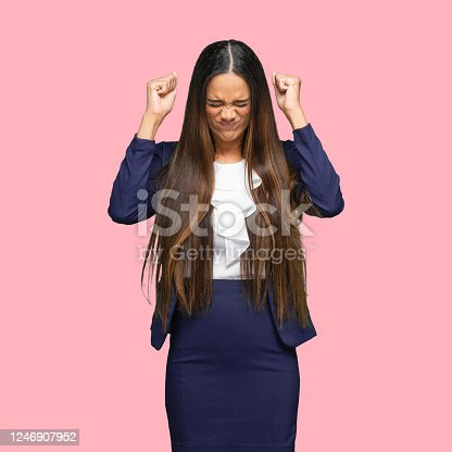 istock African-american ethnicity young women manager standing in front of colored background wearing blazer 1246907952