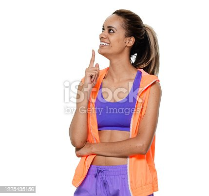 istock African-american ethnicity young women standing in front of white background wearing shorts 1225435156