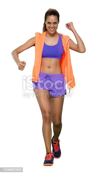 istock African-american ethnicity young women walking in front of white background wearing sports bra 1248652502